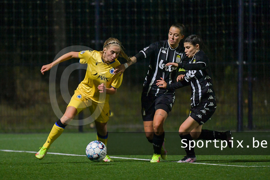 Ludmila Matavkova (9) of Club Brugge , Alysson Duterne (14) of Sporting du Pays de Charleroi and Manola Galofaro (10) of Sporting du Pays de Charleroi pictured during a female soccer game between Sporting Charleroi and Club Brugge YLA on the sixth matchday in the 2021 - 2022 season of Belgian Scooore Womens Super League , friday 8 October 2021 in Marcinelle , Belgium . PHOTO SPORTPIX | STIJN AUDOOREN