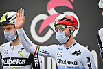 Giacomo Nizzolo (ITA) Team Qhubeka Assos sporting a helmet painted from Ekoi with an Italian self-declaration form, justifying travel from city to city for stage-hunting purposes at sign on before the start of Stage 2 of the 2021 Giro d'Italia, running 179km from Stupinigi (Nichelino) to Novara, Italy. 9th May 2021.  <br /> Picture: LaPresse/Massimo Paolone | Cyclefile<br /> <br /> All photos usage must carry mandatory copyright credit (© Cyclefile | LaPresse/Massimo Paolone)