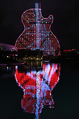HOLLYWOOD FL - OCTOBER 09: The iconic Hard Rock Guitar Hotel lights up in Red, White and Black stripes just like Eddie's Frankenstrat as they pay tribute to the late great Eddie Van Halen at the Seminole Hard Rock Hotel and Casino on October 9, 2020 in Hollywood, Florida. : Credit Larry Marano © 2020