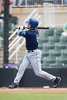 Willie Abreu (6) of the Asheville Tourists follows through on his swing against the Kannapolis Intimidators at Kannapolis Intimidators Stadium on May 7, 2017 in Kannapolis, North Carolina.  The Tourists defeated the Intimidators 4-1.  (Brian Westerholt/Four Seam Images)