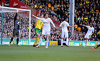 Pictured: Michu of Swansea (C) points to the corner, while Lee Camp goalkeeper for Norwich points to a goal kick. Saturday 06 April 2013<br /> Re: Barclay's Premier League, Norwich City FC v Swansea City FC at the Carrow Road Stadium, Norwich, England.