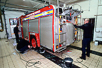 Firefighters washing the Fire Engine in the Appliance Bay at the Fire Station. This image may only be used to portray the subject in a positive manner..©shoutpictures.com..john@shoutpictures.com