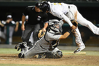 Dayton Dragons catcher Jose Ortiz (13) tags out Jamie Westbrook (2) attempting to score a run during a game against the South Bend Silver Hawks on August 20, 2014 at Four Winds Field in South Bend, Indiana.  Dayton defeated South Bend 5-3.  (Mike Janes/Four Seam Images)