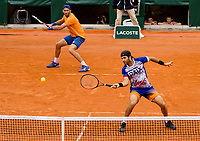 Paris, France, 3 june, 2019, Tennis, French Open, Roland Garros, Mens doubles: Jean Julien Rojer (NED) (R) and Horia Tacau (ROU)<br /> Photo: Henk Koster/tennisimages.com