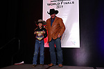 David Biggins during the bareback and saddle bronc back  number  presentation at the Junior World Finals Rodeo. Photo by Andy Watson. Written permission must be  provided  to use  this  photo  in any manner.