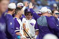 Joe Johnson (15) of the High Point Panthers is congratulated by his teammates after scoring a run during the game against the Campbell Camels at Williard Stadium on March 16, 2019 in  Winston-Salem, North Carolina. The Camels defeated the Panthers 13-8. (Brian Westerholt/Four Seam Images)