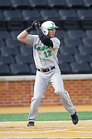 Eric Escobedo (12) of the Marshall Thundering Herd at bat against the Wake Forest Demon Deacons at Wake Forest Baseball Park on February 17, 2014 in Winston-Salem, North Carolina.  The Demon Deacons defeated the Thundering Herd 4-3.  (Brian Westerholt/Four Seam Images)