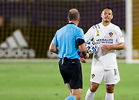 """CARSON, CA - SEPTEMBER 19: Ted Unkel and Javier """"Chicharito"""" Hernandez #14 of the Los Angeles Galaxy exchange a few words with one another during a game between Colorado Rapids and Los Angeles Galaxy at Dignity Heath Sports Park on September 19, 2020 in Carson, California."""