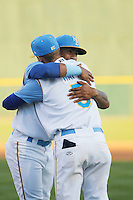 Myrtle Beach Pelicans shortstop Gleyber Torres (11) hugs second baseman Ian Happ (5) before a game against the Frederick Keys at Ticketreturn.com Field at Pelicans Ballpark on April 7, 2016 in Myrtle Beach, South Carolina. Myrtle Beach defeated Frederick 5-2. (Robert Gurganus/Four Seam Images)