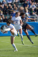Cary, North Carolina - Sunday December 6, 2015: Ashton Miller (4) of the Duke Blue Devils battles for a jump ball with Elizabeth Ball (7) during first half action at the 2015 NCAA Women's College Cup at WakeMed Soccer Park.  The Nittany Lions defeated the Blue Devils 1-0.