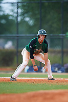 Dartmouth Big Green shortstop Nate Ostmo (19) leads off first base during a game against the Southern Maine Huskies on March 23, 2017 at Lake Myrtle Park in Auburndale, Florida.  Dartmouth defeated Southern Maine 9-1.  (Mike Janes/Four Seam Images)