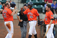 Greenville Astros right fielder Ariel Ovando #58 is greeted at home by Chase McDonald #62 and Tyler White #56 after homering in the third inning of a game against the Kingsport Mets at Pioneer Park on August 4, 2013 in Greenville, Tennessee. The Astros won the game 17-1. (Tony Farlow/Four Seam Images)