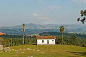 Fazenda Bauplatz, Brazil. Typical old wooden fazenda building with a view over a broad valley.