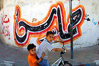 A calligraphic Arabic graffiti with the word Hamas, is seen in Gaza City June 9, 2004. Photo by Quique Kierszenbaum