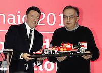 Italian prime minister Matteo Renzi, left, and President of Ferrari Sergio Marchionne, hold a F1 car model <br /> Milano 04-01-2016 Borsa <br /> Esordio in borsa per la Ferrari. <br /> The company Ferrari began trading at stock exchange today <br /> foto Daniele Buffa/Image Sport/Insidefoto