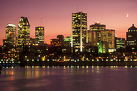 AJ0806, Canada, Quebec, Montreal, The illuminated skyline of downtown Montreal reflects in the waters of the St. Lawrence River (Fleuve Saint-Laurent) in the evening.