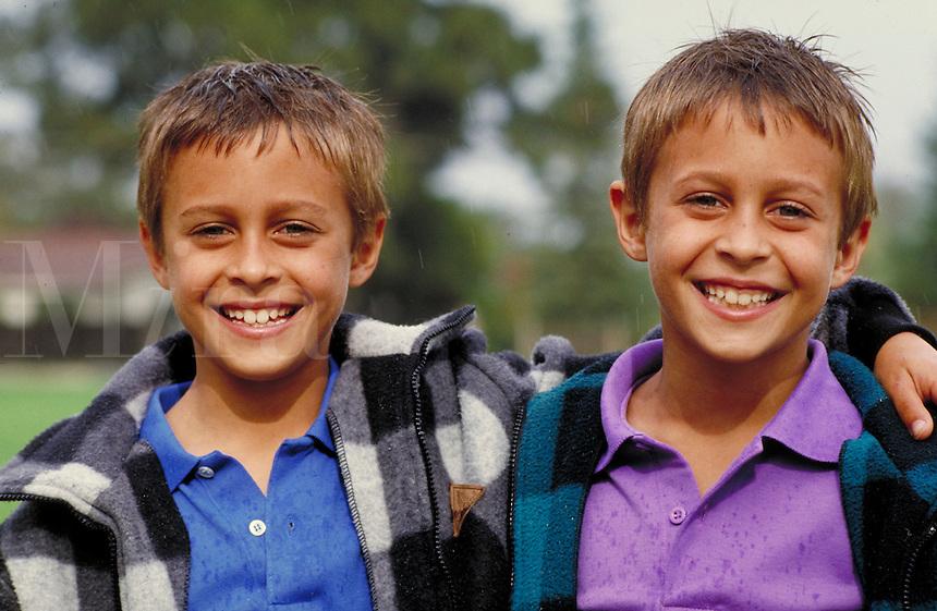 CAUCASIAN IDENTICAL TWINS. IDENTICAL TWIN BOYS. SAN FRANCISCO CALIFORNIA USA.