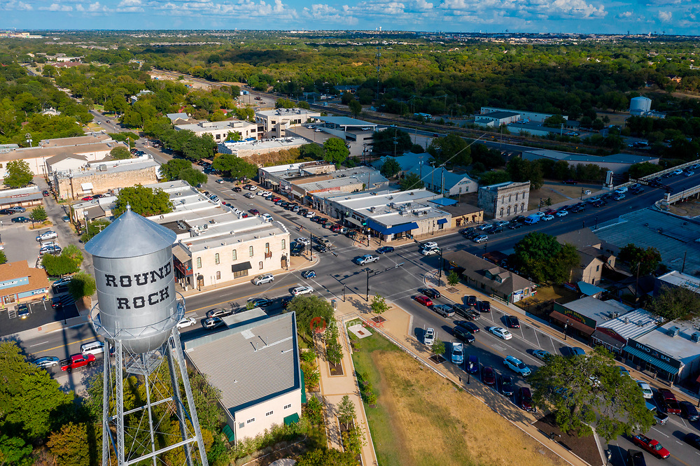 """Aerial view of the the Round Rock Koughan Memorial Water Tower Park is located in downtown Round Rock. The old water tower serves to this day as a Round Rock landmark. During the 1930s it was part of a large WPA project that not only served most of the residents of Round Rock with water and sewer hookups, but it allowed many people """"down on their luck"""" to work.  The City decorates the water tower with Christmas lights every December."""