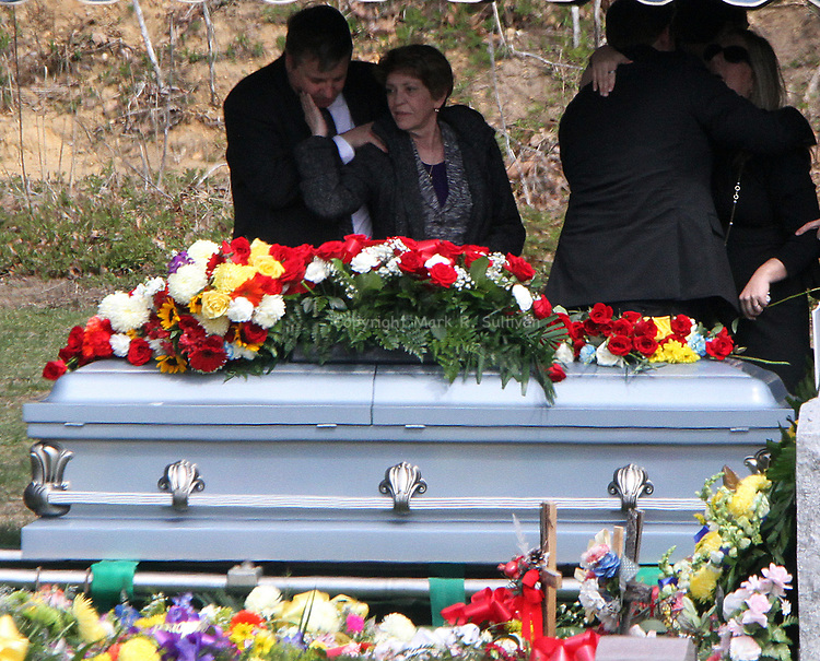 Funeral for Sayreville police detective Matthew Kurtz was held at Saint Mary's R.C. Church in South Amboy, with burial that followed at Saint Mary's Cemetery, South Amboy on Thursday March 24,2016.<br /> Family members past the casket of Kurtz, as mourners pay their respect to the fallen detective.