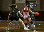 SIOUX FALLS, SD - MARCH 9: Maddie Krull #42 of the South Dakota Coyotes looks to drive to the basket past Sarah Schmitt #1 of the Omaha Mavericks during the 2021 Women's Summit League Basketball Championship at the Sanford Pentagon in Sioux Falls, SD. (Photo by Dave Eggen/Inertia)