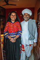 India, Gujarat, Bhadroi, Kutch Desert. Pabiben and her husband, runnning her textile business with the help of 4G internet.