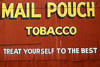 AJ3527, Chewing tobacco, tobacco, Mail Pouch, Ohio, Mail Pouch Tobacco advertisement (treat youself to the best) on the side of a red barn in Barkcamp State Park in Belmont in the state of Ohio.