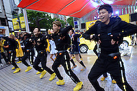 YOUNG PEOPLE ARE DANCING FOR NEW CAR PROMOTIONAL EVENT IN SHIBUYA, TOKYO