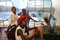 KENYA, Turkana, refugee camp Kakuma IV, JRS Jesuit refugee Service, shelter for children / KENIA, Turkana, Fluechtlingslager Kakuma 4, JRS Jesuit refugee Service, Kinderschutz Zentrum, playing at computer