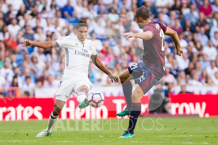 Real Madrid's Raphael Varane and Eibar's Pedro Leon durign the match of La Liga between Real Madrid and SD Eibar at Santiago Bernabeu Stadium in Madrid. October 02, 2016. (ALTERPHOTOS/Rodrigo Jimenez)