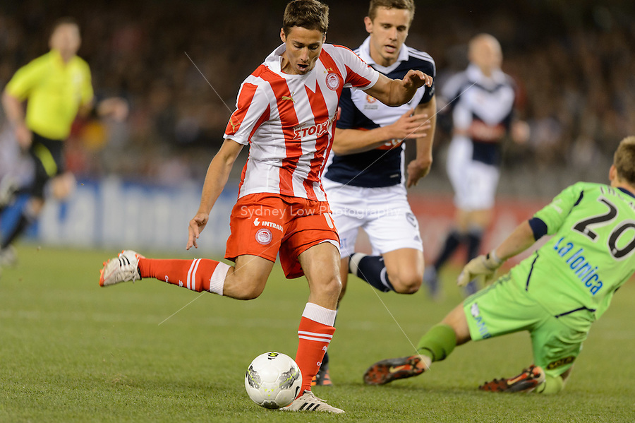 MELBOURNE, AUSTRALIA - MAY 19: David Fuster of Olympiakos kicks a goal during the match between Melbourne Victory and Olympiakos FC at Etihad Stadium on 19 May 2012 in Melbourne, Australia. (Photo Sydney Low / AsteriskImages.com)