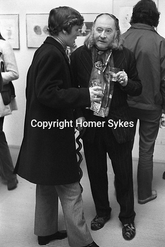 """The artist, Sir Francis Rose at David Hockney pv  """"Recent Etchings"""" at the Kasmin Gallery Bond Street London. 1969<br /> (Kasmin Gallery at 118 New Bond Street in London that John Kasmin directed from 1963 to 1972 in partnership with Sheridan Dufferin.)"""