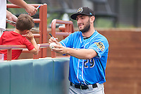 Akron RubberDucks pitcher Rob Kaminsky (29) signs an autograph for a young fan before the first game of a doubleheader against the Bowie Baysox on June 5, 2016 at Prince George's Stadium in Bowie, Maryland.  Bowie defeated Akron 6-0.  (Mike Janes/Four Seam Images)