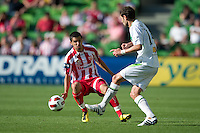 MELBOURNE, AUSTRALIA - January 2:  Aziz Behich of the Heart and Chris Grossman of the Fury contest for the ball during the round 21 A-League match between Melbourne Heart and North Queensland Fury at AAMI Park on January 2, 2011 in Melbourne, Australia. (Photo by Sydney Low / Asterisk Images)