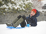 Michael Roche sledding in the snow at Woodstock View in Ennis. Photograph by John Kelly.