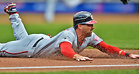 11 April 2012: Washington Nationals infielder Mark DeRosa slides safely into third during action against the New York Mets at Citi Field in Flushing, New York. The Nationals shut out the Mets 4-0 to take the rubber match of their 3-game series. Mandatory Credit: Ed Wolfstein Photo