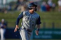 Jake Means (9) of the Columbia Fireflies hustles towards home plate against the Kannapolis Cannon Ballers at Atrium Health Ballpark on May 20, 2021 in Kannapolis, North Carolina. (Brian Westerholt/Four Seam Images)