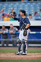 Syracuse Chiefs catcher Tuffy Gosewisch (11) signals to the defense during a game against the Lehigh Valley IronPigs on May 20, 2018 at NBT Bank Stadium in Syracuse, New York.  Lehigh Valley defeated Syracuse 5-2.  (Mike Janes/Four Seam Images)