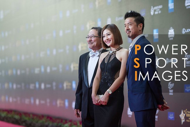 Ricky Chan (blue jacket), Danny Lau (necktie), and Cindy Lee walk the Red Carpet event at the World Celebrity Pro-Am 2016 Mission Hills China Golf Tournament on 20 October 2016, in Haikou, China. Photo by Weixiang Lim / Power Sport Images