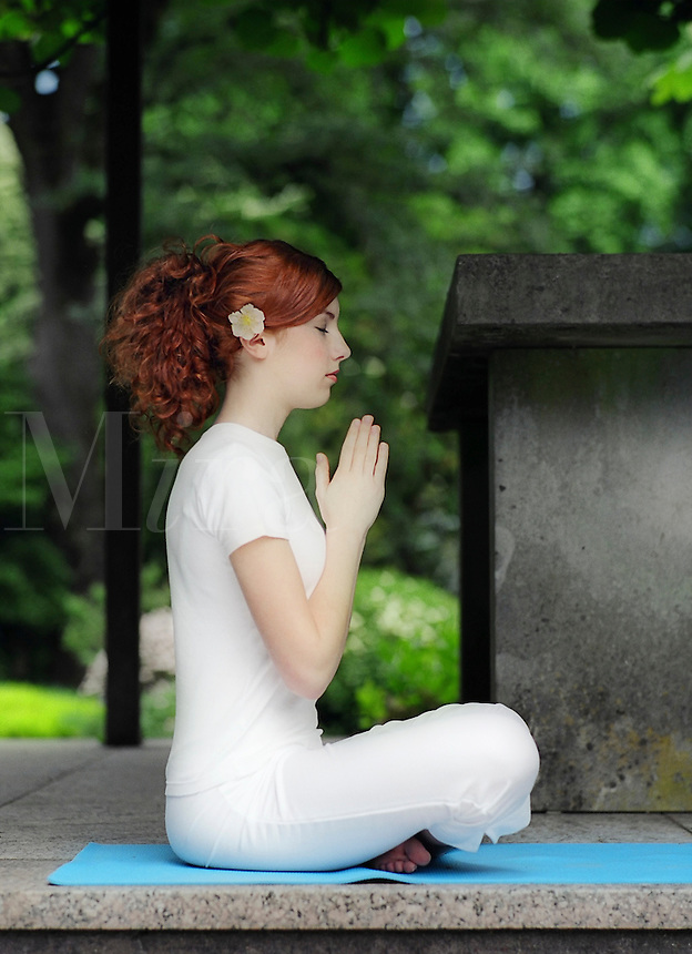 Young woman in yoga position, meditation, prayer..MR