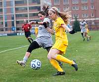 Alexa St. Martin (20) of Georgetown tries to stop the cross of Kelsey Haycook (15) of La Salle during the first round of the NCAA tournament at Shaw Field in Washington, DC.  Georgetown defeated La Salle, 2-0.