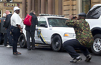 War Z Film film set in Glasgow as people look at the American police cars parked in Glasgow's George Square as filming starts on the Brad Pitt's new film..Picture: Universal News And Sport (Scotland). 16 August 2011. www.unpixs.com..