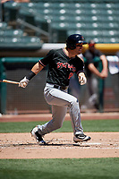 Mike Tauchman (18) of the Albuquerque Isotopes bats against the Salt Lake Bees in Pacific Coast League action at Smith's Ballpark on June 11, 2017 in Salt Lake City, Utah. The Bees defeated the Isotopes 6-5. (Stephen Smith/Four Seam Images)