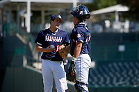 Pitcher Mason Marriott (14) talks with catcher Rene Lastres (23) during the Baseball Factory All-Star Classic at Dr. Pepper Ballpark on October 4, 2020 in Frisco, Texas.  Pitcher Mason Marriott (14), a resident of Tomball, Texas, attends Tomball High School.  (Mike Augustin/Four Seam Images)