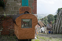 BNPS.co.uk (01202 558833)<br /> Pic: ZacharyCulpin/BNPS<br /> <br /> Pictured: The hill was made famous by Ridley Scott's 'Boy on Bike' television advert for Hovis bread.<br /> <br /> A cottage on the iconic 'Hovis Hill' is going up for auction for £150,000.<br /> <br /> The Grade II listed building is on Gold Hill in Shaftesbury, Dorset, made famous by Ridley Scott's 'Boy on Bike' television advert for Hovis bread.<br /> <br /> Number 16 Gold Hill is halfway up the hill and is in need of complete renovation, although work to extend and refurbish the property have been partly completed.<br /> <br /> Auctioneers Symonds & Sampson say once completed the cottage would make an ideal home, second home or holiday let.<br /> <br /> Gold Hill was immortalised in the 1973 Hovis ad which saw a young bakery boy struggling to push his bike up the cobbled street with a basket full of bread to the last house on his round.