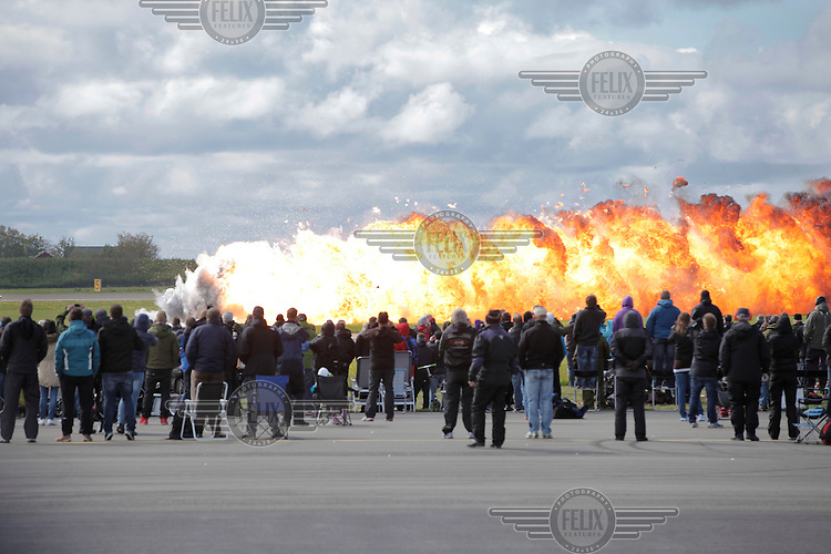 Pyrotechnics explode in a simulated air attack during Tiger Air show.  Nato Tiger Meet is an annual gathering of squadrons using the tiger as their mascot. While originally mostly a social event it is now a full military exercise. Tiger Meet 2012 was held at the Norwegian air base Ørlandet.