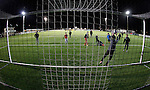Llandudno 2 Denbigh Town 2, 20/03/2015. Maesdu Park, Huws Gray Alliance Football League. Young Llandudno fans playing on the 3G pitch after the game. Needing a win to guarantee promotion to the top division of Welsh football for the first time, Llandudno took the lead twice, but were held to a draw against Denbigh Town.<br /> Llandudno installed an artificial 3G pitch in 2014. The pitch is available for hire, and enables to club to have an active community programme, and teams in every age range, all playing at Maesdu Park. Photo by Paul Thompson.