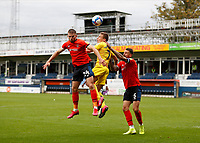 3rd October 2020; Kenilworth Road, Luton, Bedfordshire, England; English Football League Championship Football, Luton Town versus Wycombe Wanderers; David Wheeler of Wycombe Wanderers heads the ball out over Rhys Norrington-Davies and Sonny Bradley of Luton Town