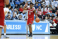 CHAPEL HILL, NC - FEBRUARY 25: Markell Johnson #11 of North Carolina State University runs the offense during a game between NC State and North Carolina at Dean E. Smith Center on February 25, 2020 in Chapel Hill, North Carolina.