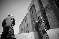 """Nagorny-Karabach, 13.05.2011, Shushi.  Zwei M?nner warten vor dem Postamt, um ihre Geh?lter ausgezahlt zu bekommen. Doch der Geldtransporter kommt nicht an diesem Tag. """"The Twentieth Spring"""" - ein Portrait der s¸dkaukasischen Stadt Schuschi, 20 Jahre nach der Eroberung der Stadt durch armenische K?mpfer 1992 im B¸gerkrieg um die Unabh?ngigkeit Nagorny-Karabachs (1991-1994). Two men waiting in front of the post office to receive their weekly salary. But the armored car didn't come without any notice. """"The Twentieth Spring"""" - A portrait of Shushi, a south caucasian town 20 years after its """"Liberation"""" by armenian fighters during the civil war for independence of Nagorny-Karabakh (1991-1994). .Deux hommes en attente devant le bureau de poste pour recevoir leur salaire hebdomadaire. Mais la voiture blindée n'est pas venu, sans aucun préavis.""""Le Vingtieme Anniversaire"""" - Un portrait de Chouchi, une ville du Caucase du Sud 20 ans après sa «libération» par les combattants arméniens pendant la guerre civile pour l'indépendance du Haut-Karabakh (1991-1994).. © Timo Vogt/Est&Ost, NO MODEL RELEASE !!"""