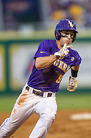 LSU Tigers shortstop Alex Bregman (8) rounds third base during a Southeastern Conference baseball game against the Texas A&M Aggies on April 24, 2015 at Alex Box Stadium in Baton Rouge, Louisiana. LSU defeated Texas A&M 9-6. (Andrew Woolley/Four Seam Images)